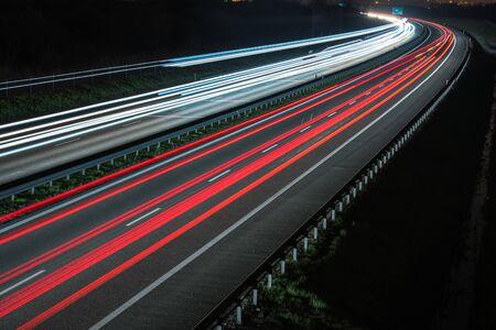 highway traffic: Night Time Highway Traffic Blur Lights. Modern Transportation.