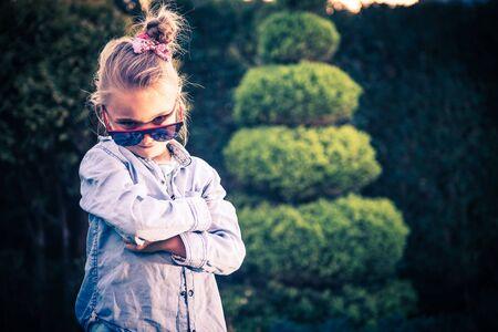 girls youth: Little Girl in Sunglasses. Smart Seven Years Old Caucasian Girl.