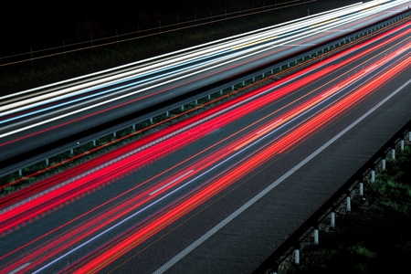 speed car: Highway Vehicle Lights Motion Blur Photography. Evening Traffic.