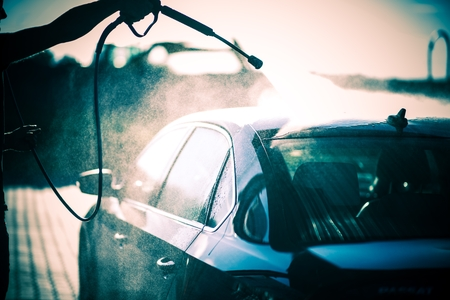 soaping: Washing the Car Using High Pressure Water Stock Photo