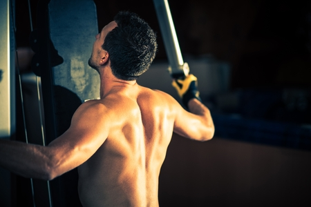 healthy men: Men in the Gym Doing Quick Workout. Fitness and Gym Theme. Stock Photo