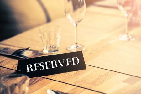 Reserved Restaurant Table. Table Reservation Table Closeup. Archivio Fotografico
