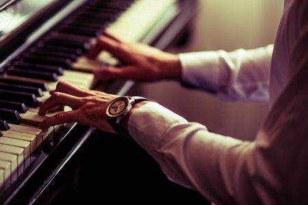 Caucasian Men Practicing Piano Playing. Closeup Photo Reklamní fotografie