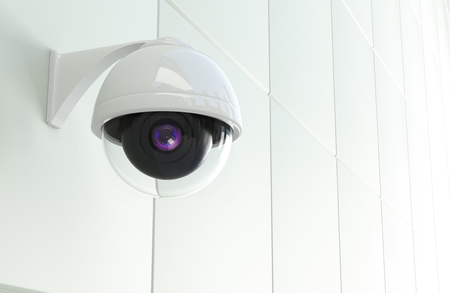 closed circuit television: Modern CCTV Network Camera Mounted to the White Modern Wall. Closed Circuit Television Theme. 3D Rendered Illustration.