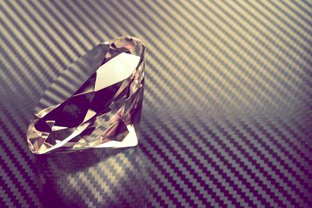 Diamond Rock on the Carbon Background Closeup Photo. Stock Photo