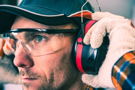 Worker Protection Equipment. Hearing Protectors and Glasses. Reklamní fotografie - 72733599