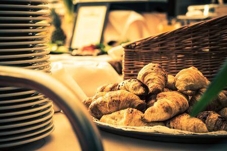 eating pastry: Fresh Italian Croissants Dessert on the Restaurant Open Table. Stock Photo