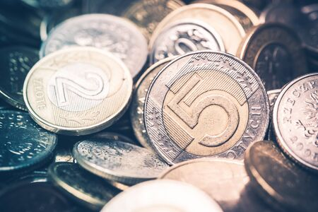 earn money: Polish Currency Coins. Five and Two Zloty Coins Closeup Photo. Warm colors. Stock Photo