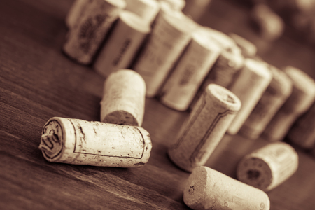Wine corks on wooden table background