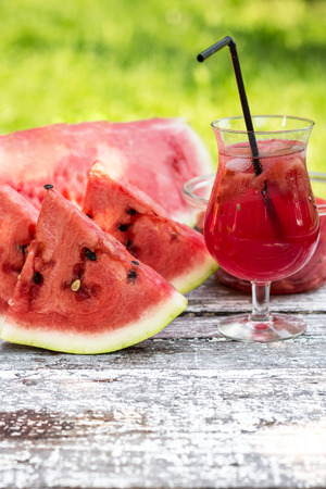 Watermelon smoothie on a wooden table photo