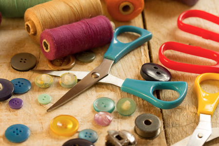 sewing tools: colorful sewing tools on a wooden table