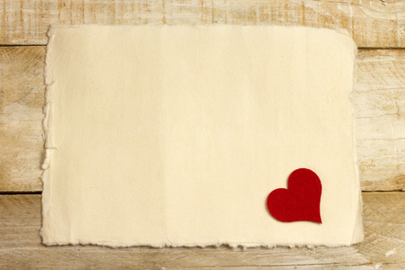 annoucement: red heart over an old paper background