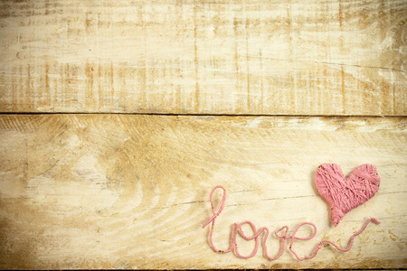Pink clew in shape of heart and word