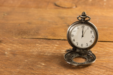 pocket watch on a vintage table