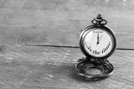 ''now is the time'' written on pocket watch