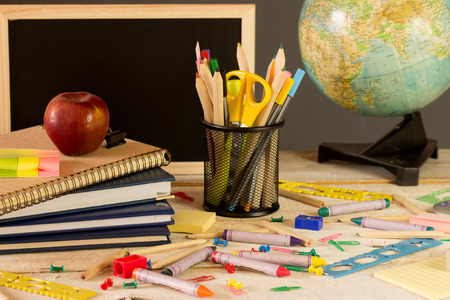 all kind of school accessories on a wooden desk photo