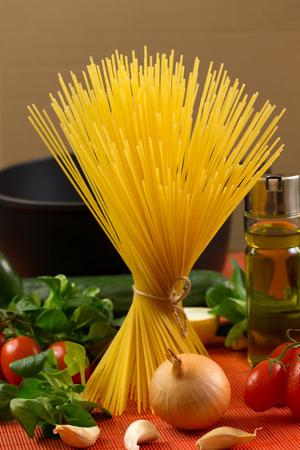 Ingredients for pasta: spaghetti, vegetables photo