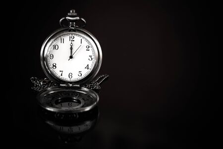 time: time is precious concept, pocket watch over a black background Stock Photo