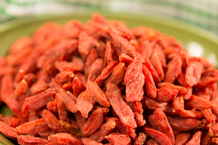 cloesup: cloesup of dried Tibetan goji berries on a green plate