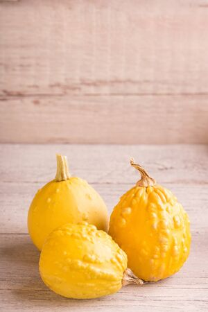 withe: little pumpkins on a withe wooden table