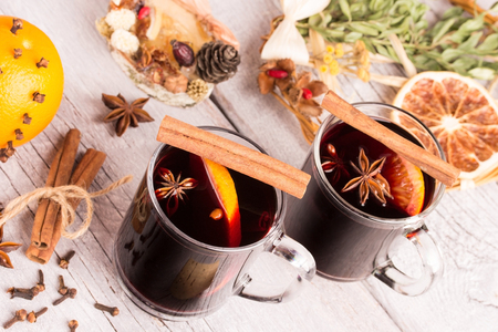 two glasses of mulled wine on white wooden table