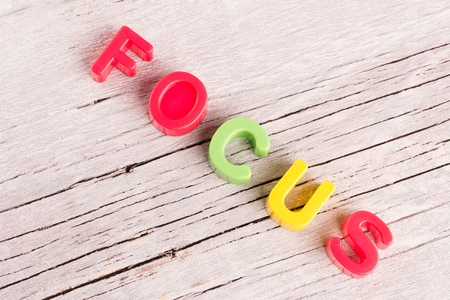 focalise: the word Focus written on white wooden background