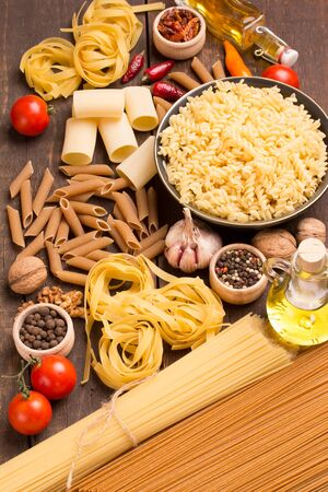 unboiled: various pasta with ingredients in rustic style