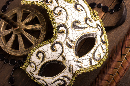 carnival party: carnival mask over dark wooden background Stock Photo