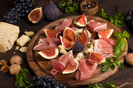 appetizers: Appetizer of figs and prosciutto Stock Photo