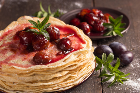confiture: delicious pancakes with homemade fresh plum`s confiture