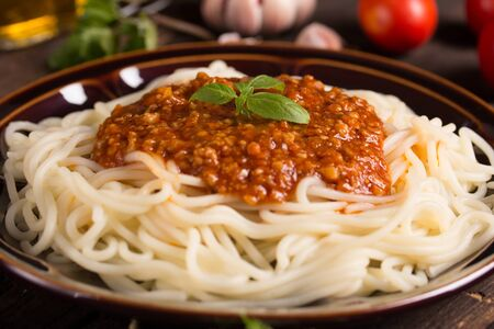 spaghetti bolognese: spaghetti bolognese with ingredients in the background Stock Photo