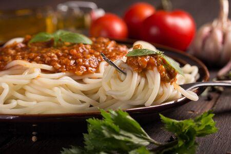 spaghetti bolognese: closeup of a plate with spaghetti bolognese