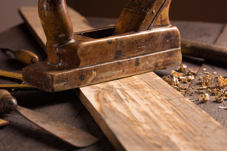 planer: Wood planer and shavings at carpenters workshop