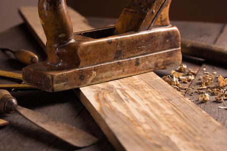 wood planer: Wood planer and shavings at carpenters workshop