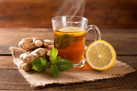 tea hot drink: ginger tea with mint and lemon Stock Photo