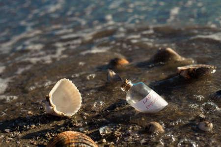 message in a bottle: last minute message in a bottle on beautiful beach Stock Photo
