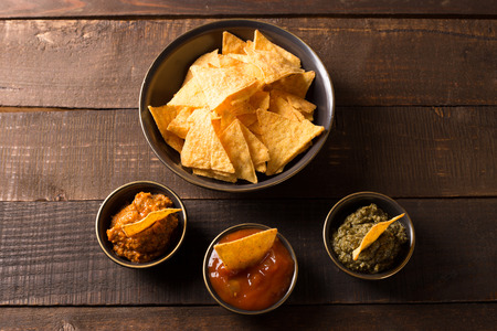 tortilla chips: top view of tortilla chips with various sauces Stock Photo