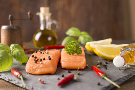portions: portions of fresh salmon fillet with aromatic herbs, spices Stock Photo