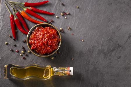 chili sauce: chili sauce on a stoneboard
