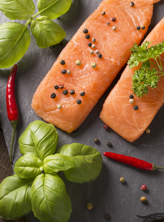 filets: vertical composition of deliious salmon filets with herbs and spices Stock Photo