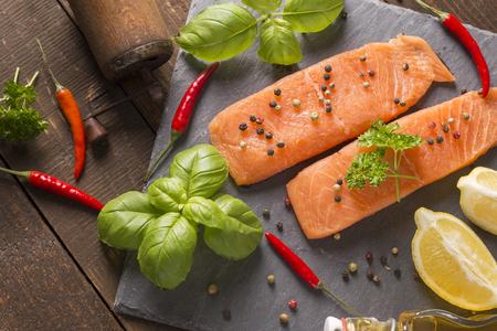 salmon filet: raw salmon filet on a stone board Stock Photo