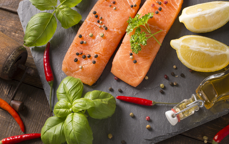 filets: top view of raw salmon filets with spices