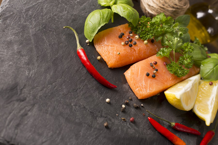 salmon filet: top view of raw salmon filet with herbs and spices