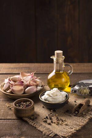 Garlic dip on wooden background
