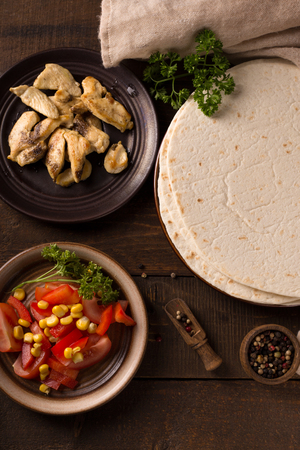 mais: Stack of homemade tortilla on wooden table background