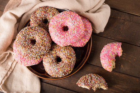 dough nut: donuts on rustic kitchen table Stock Photo