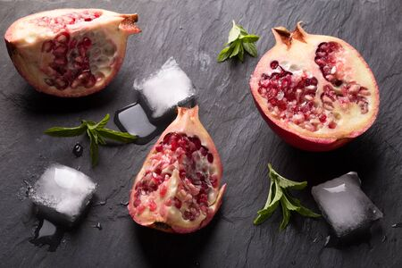 scatters: fresh juicy pomegranate on a table
