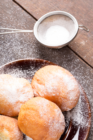 homemade  traditional donuts with powdered sugar