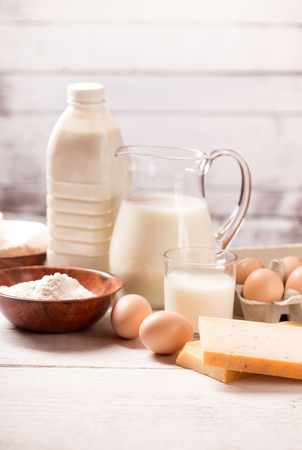 Milk and dairy products on wooden table