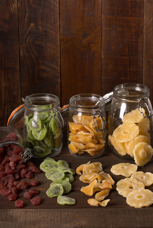 dried fruits over wooden background